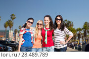 Купить «teenage girls or young women over venice beach», фото № 28489789, снято 31 августа 2013 г. (c) Syda Productions / Фотобанк Лори