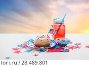 Купить «donut with juice and candies on independence day», фото № 28489801, снято 28 мая 2015 г. (c) Syda Productions / Фотобанк Лори