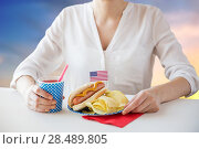 Купить «woman celebrating american independence day», фото № 28489805, снято 28 мая 2015 г. (c) Syda Productions / Фотобанк Лори