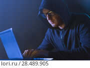Купить «hacker using laptop computer for cyber attack», фото № 28489905, снято 9 ноября 2017 г. (c) Syda Productions / Фотобанк Лори