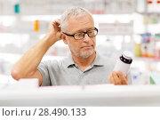 Купить «senior male customer with drug at pharmacy», фото № 28490133, снято 27 июня 2015 г. (c) Syda Productions / Фотобанк Лори