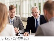 Купить «smiling business people meeting in office», фото № 28490205, снято 3 июля 2016 г. (c) Syda Productions / Фотобанк Лори