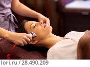 Купить «woman having hydradermie facial treatment in spa», фото № 28490209, снято 26 января 2017 г. (c) Syda Productions / Фотобанк Лори