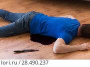 dead man body lying on floor at crime scene. Стоковое фото, фотограф Syda Productions / Фотобанк Лори