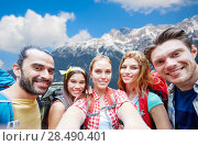 Купить «friends with backpack taking selfie over mountains», фото № 28490401, снято 25 июля 2015 г. (c) Syda Productions / Фотобанк Лори