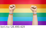 Купить «hands with gay pride rainbow wristbands shows fist», фото № 28490429, снято 2 ноября 2017 г. (c) Syda Productions / Фотобанк Лори