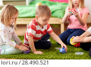 Купить «kids and mother with modelling clay or slimes», фото № 28490521, снято 15 октября 2017 г. (c) Syda Productions / Фотобанк Лори