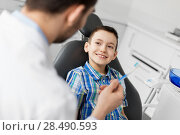 Купить «dentist giving toothbrush to kid patient at clinic», фото № 28490593, снято 22 апреля 2018 г. (c) Syda Productions / Фотобанк Лори