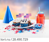 Купить «cupcakes with american flags on independence day», фото № 28490729, снято 28 мая 2015 г. (c) Syda Productions / Фотобанк Лори
