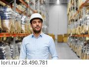 Купить «businessman in helmet at warehouse», фото № 28490781, снято 9 декабря 2015 г. (c) Syda Productions / Фотобанк Лори