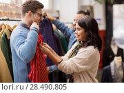 Купить «couple choosing clothes at vintage clothing store», фото № 28490805, снято 30 ноября 2017 г. (c) Syda Productions / Фотобанк Лори