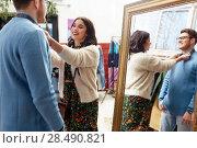 Купить «couple choosing clothes at vintage clothing store», фото № 28490821, снято 30 ноября 2017 г. (c) Syda Productions / Фотобанк Лори