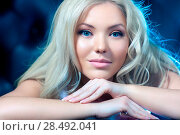 Купить «Young woman portrait. Soft blue tint.», фото № 28492041, снято 19 июня 2018 г. (c) Ingram Publishing / Фотобанк Лори