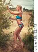 Купить «Young sexy woman outdoors. Soft yellow tint.», фото № 28492145, снято 19 июня 2018 г. (c) Ingram Publishing / Фотобанк Лори