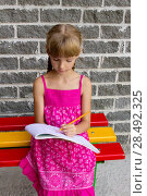 Купить «Girl draws on the album sitting bench 5054», фото № 28492325, снято 22 октября 2018 г. (c) Ingram Publishing / Фотобанк Лори