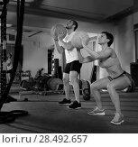 Купить «Crossfit ball fitness workout group woman and man at gym», фото № 28492657, снято 21 января 2020 г. (c) Ingram Publishing / Фотобанк Лори