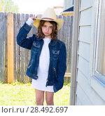 Купить «Little kid girl pretending to be a cowboy with father hat and jacket», фото № 28492697, снято 22 января 2019 г. (c) Ingram Publishing / Фотобанк Лори