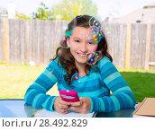 Купить «American latin teen girl with smartphone doing homework on backyard», фото № 28492829, снято 16 июля 2019 г. (c) Ingram Publishing / Фотобанк Лори