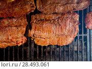 Купить «Beef meat barbecue grilled with embers and smoke american style», фото № 28493061, снято 23 марта 2019 г. (c) Ingram Publishing / Фотобанк Лори