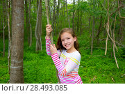 Купить «Happy children girl playing in forest park jungle with liana smiling», фото № 28493085, снято 21 апреля 2019 г. (c) Ingram Publishing / Фотобанк Лори