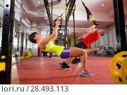 Купить «Crossfit fitness TRX training exercises at gym woman and man push-ups workout», фото № 28493113, снято 19 апреля 2019 г. (c) Ingram Publishing / Фотобанк Лори