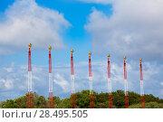 Купить «Airport lights for aircraft landing on blue sky», фото № 28495505, снято 30 мая 2013 г. (c) Ingram Publishing / Фотобанк Лори