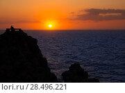 Купить «Ciutadella Menorca at Punta Nati orange sunset with girl backlight», фото № 28496221, снято 24 мая 2013 г. (c) Ingram Publishing / Фотобанк Лори