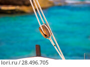 Boat classic pulley from sailboat in Mediterranean at Balearic Islands. Стоковое фото, фотограф Tono Balaguer / Ingram Publishing / Фотобанк Лори