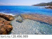 Denia Alicante Las rotas rocky beach in Spain and San Antonio Cape. Стоковое фото, фотограф Tono Balaguer / Ingram Publishing / Фотобанк Лори