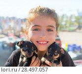 Купить «Kid girl playing with puppy dogs smiling with blue eyes», фото № 28497057, снято 21 сентября 2013 г. (c) Ingram Publishing / Фотобанк Лори
