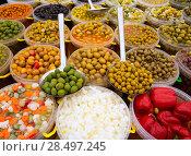 Купить «Pickles varied olives onion carrot lupins hot pepper gherkin in a row», фото № 28497245, снято 6 октября 2013 г. (c) Ingram Publishing / Фотобанк Лори