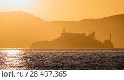 Купить «Alcatraz island penitentiary at sunset backlight in san Francisco California USA», фото № 28497365, снято 20 апреля 2013 г. (c) Ingram Publishing / Фотобанк Лори