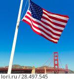 Купить «Golden Gate Bridge with United States flag in San Francisco California USA», фото № 28497545, снято 21 апреля 2013 г. (c) Ingram Publishing / Фотобанк Лори
