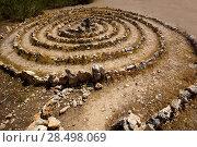 Купить «Atlantis spiral sign in Ibiza with stones on soil at Balearic Islands», фото № 28498069, снято 9 июня 2013 г. (c) Ingram Publishing / Фотобанк Лори