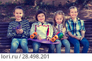 Купить «Positive kids posing together outdoor», фото № 28498201, снято 22 сентября 2018 г. (c) Яков Филимонов / Фотобанк Лори