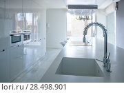 Купить «Modern white kitchen perspective with integrated bench sink and spring faucet», фото № 28498901, снято 29 февраля 2008 г. (c) Ingram Publishing / Фотобанк Лори