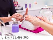 Купить «Nails saloon woman nail polish remove with tissue for new manicure», фото № 28499365, снято 18 ноября 2013 г. (c) Ingram Publishing / Фотобанк Лори