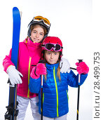 Купить «Siters kid girls with ski poles helmet and goggles going to winter snow», фото № 28499753, снято 1 февраля 2014 г. (c) Ingram Publishing / Фотобанк Лори