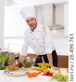 Купить «Chef male portrait on white countertop with food at kitchen», фото № 28499761, снято 9 февраля 2014 г. (c) Ingram Publishing / Фотобанк Лори
