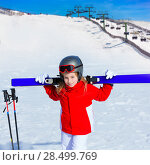Купить «Kid girl winter snow holding ski equipment helmet goggles poles», фото № 28499769, снято 26 января 2014 г. (c) Ingram Publishing / Фотобанк Лори