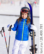 Купить «Kid girl winter snow with ski equipment helmet goggles poles», фото № 28499781, снято 26 января 2014 г. (c) Ingram Publishing / Фотобанк Лори