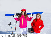 Купить «Kid girls sister in winter snow with ski equipment helmet goggles poles», фото № 28499785, снято 26 января 2014 г. (c) Ingram Publishing / Фотобанк Лори