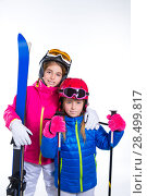 Купить «Siters kid girls with ski poles helmet and goggles going to winter snow», фото № 28499817, снято 1 февраля 2014 г. (c) Ingram Publishing / Фотобанк Лори