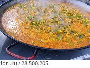Купить «Cooking paella typical from Valencia Spain recipe with rice beans chicken and good hand», фото № 28500205, снято 20 октября 2013 г. (c) Ingram Publishing / Фотобанк Лори