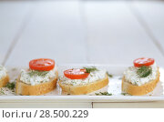 Купить «Cottage cheese sandwiches set with tomato and dill on white table», фото № 28500229, снято 24 апреля 2013 г. (c) Ingram Publishing / Фотобанк Лори