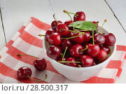 Купить «Ceramic White Bowl of organic Cherries on white table», фото № 28500317, снято 7 июня 2013 г. (c) Ingram Publishing / Фотобанк Лори