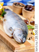Купить «Raw trout on the chopping board with lemon and spices», фото № 28500337, снято 20 марта 2013 г. (c) Ingram Publishing / Фотобанк Лори