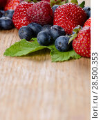 Купить «Strawberries raspberries and blueberries on the wooden table macro», фото № 28500353, снято 16 августа 2013 г. (c) Ingram Publishing / Фотобанк Лори