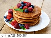 Купить «Stack of pancakes with strawberries raspberries and blueberries on white plate», фото № 28500381, снято 16 августа 2013 г. (c) Ingram Publishing / Фотобанк Лори