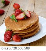 Купить «Ready to eat pancakes with strawberries on the white plate», фото № 28500589, снято 21 мая 2019 г. (c) Ingram Publishing / Фотобанк Лори